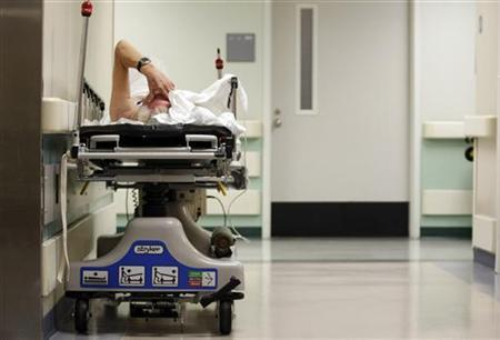 A patient waits in the hallway for a room to open up in the emergency room in Houston, Texas