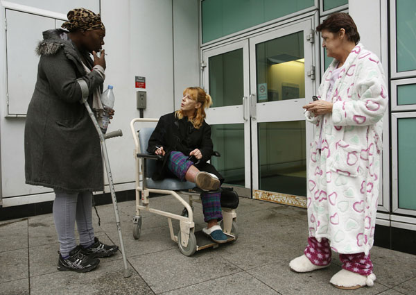 Patients smoke outside University College Hospital in central London
